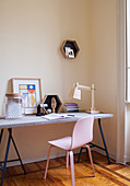 Ornaments on DIY desk with pink chair