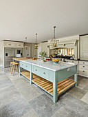 Cream country-house kitchen with huge light blue island counter