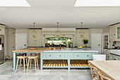 Cream country-house kitchen with huge pale blue island counter