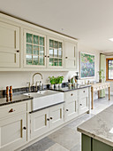 Cream country-house kitchen with black marble worktops