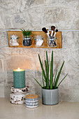 DIY organiser made from board and glass jars in bathroom