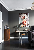 Dark grey floor and grey walls in eclectic period interior
