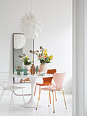 Vintage-style designer furniture in white, feminine dining room