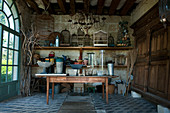 Antique gardening equipment and vintage accessories in summerhouse