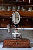 Mirror and shaving utensils on antique wooden stand
