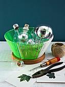 Light bulbs and tools for making light bulb vases