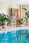 Swimming pool decorated in Urban Jungle style with houseplants