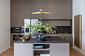 Vase of eucalyptus in grey modern kitchen