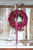 Purple wreath of rose hips, amaranth and ribbons