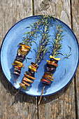 Colourful potatoes grilled on sprigs of rosemary