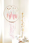 Handmade dream catcher with paper feathers