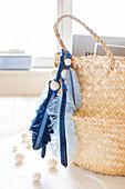Handmade denim feathers and felt beads on raffia basket