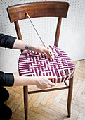 Repairing old chair with handmade woven seat
