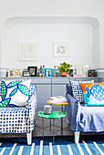 Blue-and-white, polka-dot, loose-covered armchairs with decorative scatter cushions