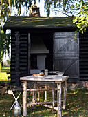 Rustic table in front of shed