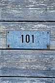 Zinc plate with number 101 on board wall