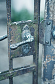 Artistic handle on old garden gate