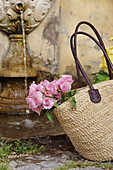 Roses in raffia basket