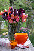Vase of tulips on terrace table