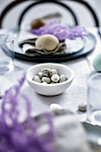 Speckled chocolate eggs on Easter table set in a natural style