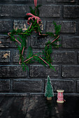 Christmas decoration on dark brick wall