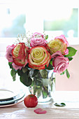Bouquet of roses and gypsophila in vase on table