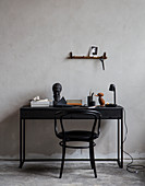 Black bistro chair at desk with vintage accessories