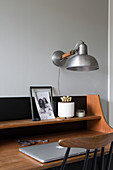 Vintage, wall-mounted lamps above mid-century desk