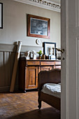 Antique furniture, wainscoting and stucco ceiling in bedroom
