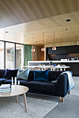 Dark blue sofa in multifunctional interior