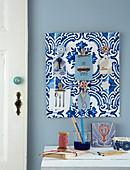 Handmade key rack covered in blue-and-white wallpaper with Azulejo pattern