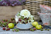 Autumn arrangement with dahlia, hydrangea blossoms and unripe berries