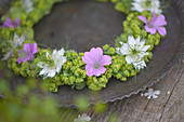 Summer wreath of lady's mantle, cranesbill and maiden in the green