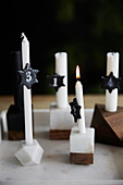 White Advent candles with black numbered tags