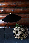 Ball of pine cones below black table lamp