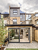 Paved terrace and conservatory of terraced house