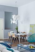 Modern designer lamp above dining table in loft apartment