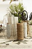 Utensils for making plant hanger: Glass jar, twine, scissors and plants