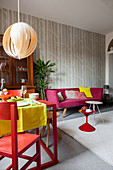 Brightly coloured accents in multifunctional living room