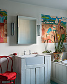 Wood-clad sink, bathtub and wainscoting in bathroom