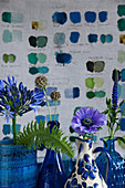 Agapanthus, scabious, anemone and veronica in blue vases