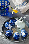 Blue marbled Easter eggs and Easter bunny figurine