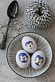 Easter eggs decorated with pressed violas