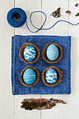 Blue Easter eggs in small baskets