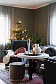 Wing-back armchairs and Christmas tree in cosy living room