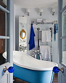 Free-standing bathtub in blue-and-white bathroom