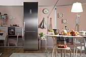 Floor-to-ceiling stainless-steel fridge as decorative furnishing in kitchen
