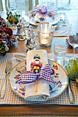 Table festively set with nutcracker lollipops on plates