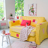 Yellow sofa enhanced with patchwork in romantic living room