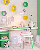 Pretty home study in fresh green with creative decorations